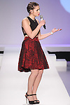 Teenage singer Carly Rose Sonenclar performs on the runway at the during the Kids Rock fashion show presented by Haddad Brands, during Mercedes-Benz Fashion Week Fall 2015.