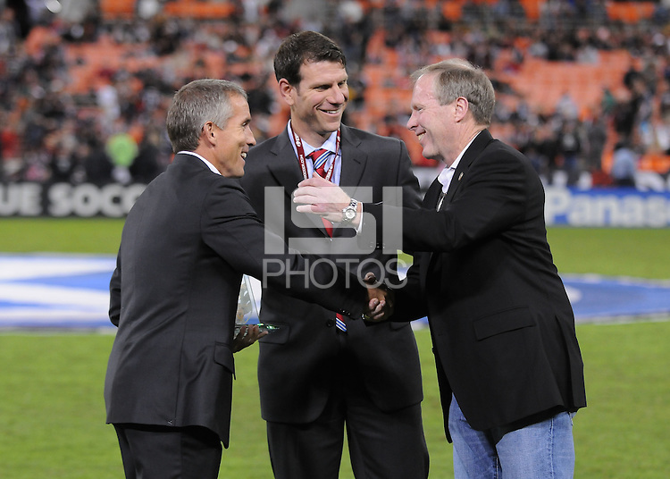 Former D.C. United Player Richie Williams receives from D.C. United President and CEO  Kevin Payne a plaque for the induction to the D.C. United Wall of Fame, with him former player Jeff Agoos in the middle. The Chicago Fire defeated D.C. United 2-1 at RFK Stadium, Saturday October 15, 2011.