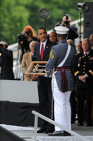 US President Barack Obama receives a West Point Saber as a present from the 2010 class during the graduation and commissioning ceremony at the United States Military Academy at West Point  in West Point, New York. May 22, 2010Credit: Dennis Van Tine/MediaPunch