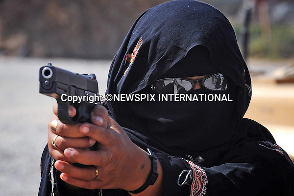 """AFGHAN FEMALE POLICE.Women in Afghanistan have made history by joining the Afghan National Police..Photo shows: Female Afghan National Police ( ANP) members carrying out weapon training on the Sig Sauer 9 mm pistol, Lashkar Gah_16/09/09.Photo Credit: ©Wood_Newspix International..**ALL FEES PAYABLE TO: """"NEWSPIX INTERNATIONAL""""**..PHOTO CREDIT MANDATORY!!: NEWSPIX INTERNATIONAL..IMMEDIATE CONFIRMATION OF USAGE REQUIRED:.Newspix International, 31 Chinnery Hill, Bishop's Stortford, ENGLAND CM23 3PS.Tel:+441279 324672  ; Fax: +441279656877.Mobile:  0777568 1153.e-mail: info@newspixinternational.co.uk"""