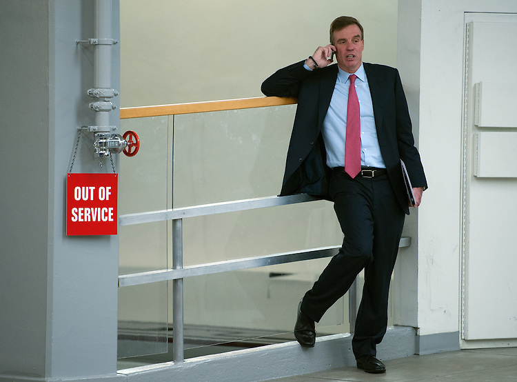 UNITED STATES - June 25: Sen. Mark Warner, D-VA., pauses to talk on his cell phone as he makes his way into the U.S. Capitol on June 25, 2013 for the Senate luncheons. (Photo By Douglas Graham/CQ Roll Call)