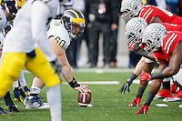 Michigan Wolverines offensive lineman Jack Miller (60) looks at the Ohio State Buckeyes defense line before a snap in the 1st quarter of their game at Ohio Stadium in Columbus, Ohio on November 29, 2014.  (Dispatch photo by Kyle Robertson)