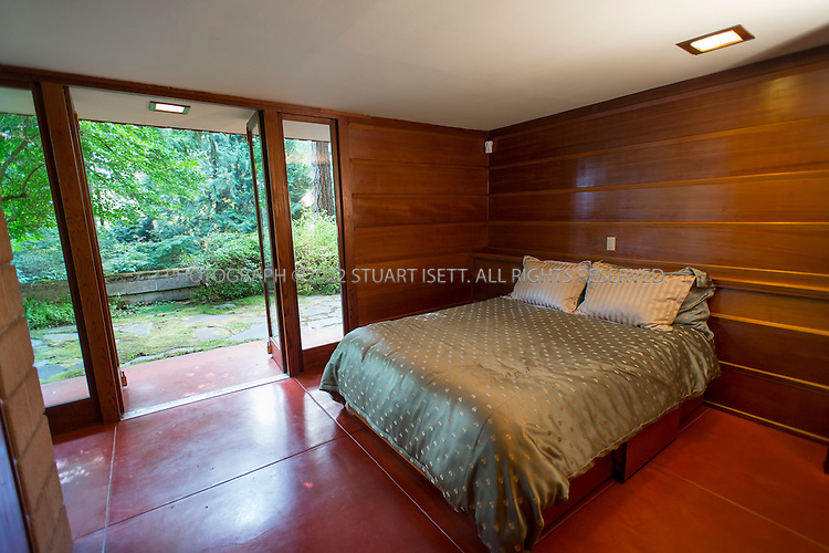 """10/9/2012--Sammamish, WA, USA..VIEW: Master bedroom...Architect Frank Lloyd Wright planned his """"Usonian"""" homes to be affordable for middle-class families. The 1,9500 square foot Brandes home is for sale in Sammamish, Washington (30 minutes from Seattle) at $1.39 million. It features three bedrooms, two bathrooms and a small, separate office/study space...The home was built in 1952, and has redwood trim and Wright's original furniture and some garden sculptures by Wright. It's one of only three Frank Lloyd Wright homes near Seattle...©2012 Stuart Isett. All rights reserved."""