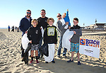 Kieran Tintle (L) Area Manager, External Affairs for Jersey Central Power & Light and Belmar Mayor Matt Doherty join the Lawrence Family (Front Row L to R) Triplets Colin, Cormac and Ciaran, 11 years old and Calleigh, 8 with father Frank Lawrence (R) at the JCP&L sponsored Beach Sweep in Belmar, NJ 10/21/17.