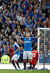 Still with back to goal, Andy Halliday lifts his arms in the air realising that St Mirren have missed their penalty