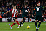 John Egan (L) of Sheffield United passes the ball during the Premier League match at Bramall Lane, Sheffield. Picture date: 5th December 2019. Picture credit should read: James Wilson/Sportimage