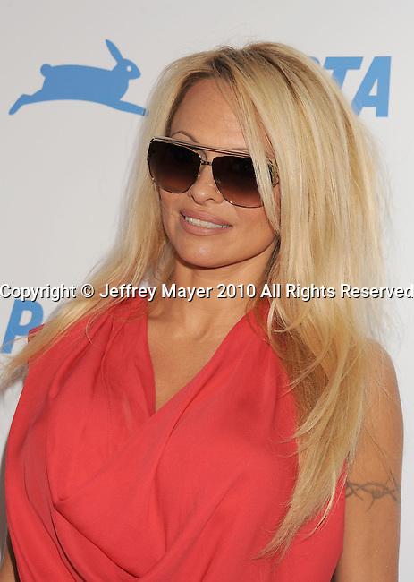 HOLLYWOOD, CA. - September 25: Pamela Anderson arrives at PETA's 30th Anniversary Gala And Humanitarian Awards at The Hollywood Palladium on September 25, 2010 in Hollywood, California.