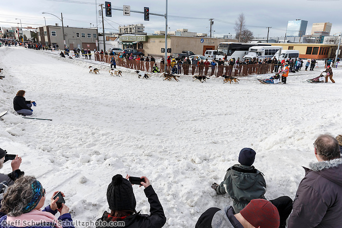 Kim Franklin makes the turn at Cordova Street during the Ceremonial Start of the 2016 Iditarod in Anchorage, Alaska.  March 05, 2016