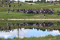 A crowd crossing to the 12th fairway during Round 3 of the Open de Espana 2018 at Centro Nacional de Golf on Saturday 14th April 2018.<br /> Picture:  Thos Caffrey / www.golffile.ie<br /> <br /> All photo usage must carry mandatory copyright credit (&copy; Golffile | Thos Caffrey)