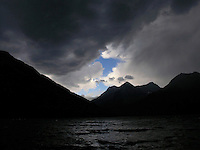 An afternoon storm moves over Quartz Lake in Glacier Park, Montana. Photo by Jason Cohn