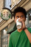 Montreal (Qc) CANADA - August 19 2009 - model released photo - asian (Filipino) male teen drink starbucks coffee on Notre-Dame street in  Old-Montreal