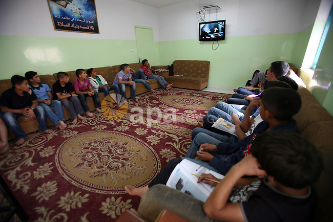 Palestinian orphan children watch TV at the Hebron's orphan house, in the West Bank city of Hebron 24 May 2012.  Hebron's orphan house  contain about 100 orphan children from ages 6 to 18 years old, and oversees some of orphans in their houses. Photo by Mamoun Wazwaz
