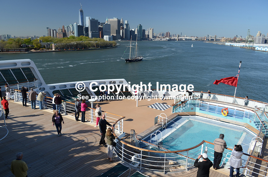 Early boarders on the May 2013 voyage to Southampton, UK, get a panoramic view of New York, USA, from the stern of the Queen Mary 2. 201305042352<br /> <br /> Copyright Image from Victor Patterson, 54 Dorchester Park, Belfast, UK, BT9 6RJ<br /> <br /> Tel: +44 28 9066 1296<br /> Mob: +44 7802 353836<br /> Voicemail +44 20 8816 7153<br /> Skype: victorpattersonbelfast<br /> Email: victorpatterson@me.com<br /> Email: victorpatterson@ireland.com (back-up)<br /> <br /> IMPORTANT: If you wish to use this image or any other of my images please go to www.victorpatterson.com and click on the Terms &amp; Conditions. Then contact me by email or phone with the reference number(s) of the image(s) concerned.