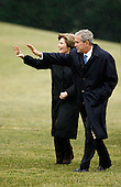 Washington, DC - January 10, 2009 -- United States President George W. Bush (R) and First Lady Laura Bush wave to guests after returing the White House  January 10, 2009 in Washington, DC. Bush and his family returned from Norfolk, Virginia, where he commissioned the USS George H.W. Bush (CVN 77), the Navy aircraft carrier named for his father and former President George H.W. Bush.  .Credit: Chip Somodevilla - Pool via CNP
