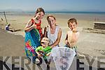 Katelyn Leen, Alex Leen, Rosaleen Godley, and Brandon Leen from Ballyheigue enjoying the sunshine at Ballyheigue beach on Tuesday.