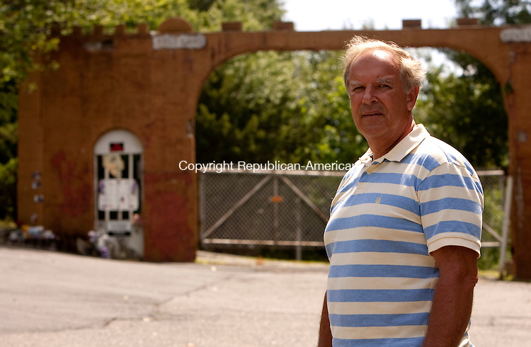 WATERBURY CT 22  JULY, 2010-072210JS06-Bill Fitzpatrick, a resident of Ayers Street in Waterbury, poses in front of the entrance to Holy Land near his home. <br /> Jim Shannon Republican-American