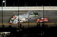 Feb 13, 2009; Daytona Beach, FL, USA; NASCAR Camping World Truck Series driver Brian Scott (16) spins after contact with Mike Bliss (40) during the NextEra Energy Resources 250 at Daytona International Speedway. Mandatory Credit: Mark J. Rebilas-