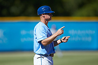 Burlington Royals manager Brooks Conrad (12) coaches third base during the game against the Greeneville Reds at Burlington Athletic Stadium on July 8, 2018 in Burlington, North Carolina. The Royals defeated the Reds 4-2.  (Brian Westerholt/Four Seam Images)
