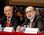 """Washington, D.C. - September 23, 2008 -- United States Secretary of the Treasury Henry M. Paulson, left, and Ben S. Bernanke, Chairman, Board of Governors of the Federal Reserve System, right, testify before the United States Senate Committee on Banking, Housing and Urban Affairs on """"Turmoil in US Credit Markets: Recent Actions Regarding Government Sponsored Entities, Investment Banks and Other Financial Institutions"""" in Washington, D.C. on Tuesday, September 23, 2008.  The hearing focused on the United States Government's proposed 700 billion U.S. dollar bail-out of the banking system caused by poor lending practices of U.S. banks..Credit: Ron Sachs / CNP"""