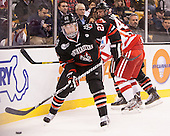 Colton Saucerman (NU - 23) - The Northeastern University Huskies defeated the Boston University Terriers 3-2 in the opening round of the 2013 Beanpot tournament on Monday, February 4, 2013, at TD Garden in Boston, Massachusetts.
