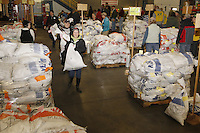 Wednesday, February 13, 2013.  Volunteers weigh, sort and stack musher's food drop bags at Airland Transport in Anchorage to be sent out to the 22 checkpoints along the trail.