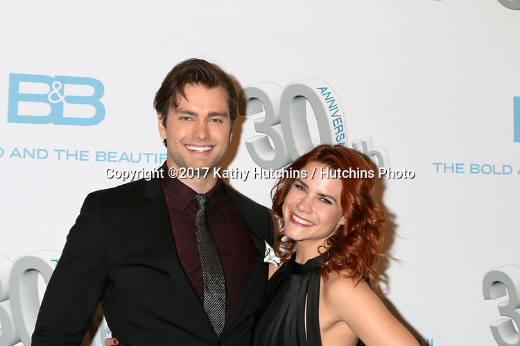 LOS ANGELES - MAR 23:  Pierson Fode, Courtney Hope at the On Set celebration of 30 Years of Bold and Beautiful and their 23 Daytime Emmy nominations at CBS Televsision City on March 23, 2017 in Los Angeles, CA