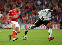 (L-R) Hal Robson-Kanu of Wales avoids Kevin Danso of Austria during the FIFA World Cup Qualifier Group D match between Wales and Austria at The Cardiff City Stadium, Cardiff, Wales, UK. Saturday 02 September 2017