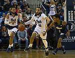 Nevada forward Caleb Martin (10) is pressured by Akron guard Loren Cristian Jackson (1) as his twin brother Cody Martin (11) looks on in the first half of an NCAA college basketball game in Reno, Nev., Saturday, Dec. 22, 2018. (AP Photo/Tom R. Smedes)