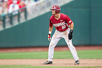 Arkansas Razorbacks outfielder Andrew Benintendi (16) takes his lead off of second base against the Virginia Cavaliers in Game 1 of the NCAA College World Series on June 13, 2015 at TD Ameritrade Park in Omaha, Nebraska. Virginia defeated Arkansas 5-3. (Andrew Woolley/Four Seam Images)