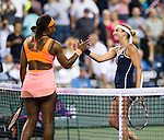 Serena Williams (USA) and Timea Bacsinszky (SUI) shake hands after their quarterfinal match. Serena defeated a tough Bacsinszky with a score of 75 63 at the BNP Parisbas Open in Indian Wells, CA on March 18, 2015.