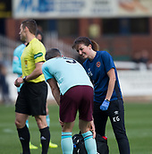 30th September 2017, Dens Park, Dundee, Scotland; Scottish Premier League football, Dundee versus Hearts; Hearts physio Karen Gibson checks out Hearts' Aaron Hughes before the defender went of injured early in the match