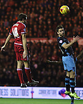 Cristhian Stuani of Middlesbrough heading the ball past Rhoys Wiggins of Sheffield Wednesday - Sky Bet Championship - Middlesbrough vs Sheffield Wednesday - Riverside Stadium - Middlesbrough - England - 28th of December 2015 - Picture Jamie Tyerman/Sportimage