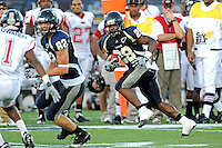 27 November 2010:  FIU running back Darriet Perry (28) takes a pass for extra yards in the second quarter as the FIU Golden Panthers defeated the Arkansas State Red Wolves, 31-24, at FIU Stadium in Miami, Florida.
