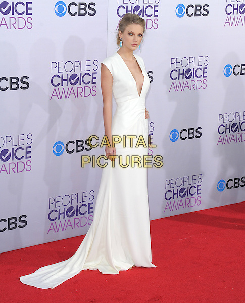 Taylor Swift.The 2013 People's Choice Awards held at Nokia Live in Los Angeles, California 9th January 2013                                                                   .full length white dress plunging neckline  cleavage .CAP/DVS.©DVS/Capital Pictures.