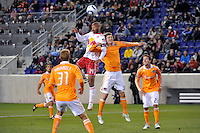 Thierry Henry (14) of the New York Red Bulls and Bobby Boswell (32) of the Houston Dynamo go up for a header during a Major League Soccer (MLS) match at Red Bull Arena in Harrison, NJ, on April 02, 2011.