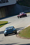 Eric Bretzel, in his 1972 Porsche 911 RSR, follows the 1963 Chevrolet Corvette coupe of Jerry Groose at the Kohler International Challenge with Brian Redman, 2006<br /> <br /> Please contact me for full-size images.<br /> <br /> For non-editorial usage, releases are the responsibility of the licensee.