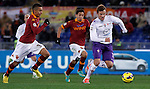 Calcio, Serie A: Roma vs Fiorentina. Roma, stadio Olimpico, 8 dicembre 2012..Fiorentina forward Haris Seferovic, of Switzerland, right, is chased by AS Roma defenders Marquinhos, of Brazil, left, and Ivan Piris, of Paraguay, during the Italian Serie A football match between AS Roma and Fiorentina at Rome's Olympic stadium, 8 december 2012..UPDATE IMAGES PRESS/Isabella Bonotto