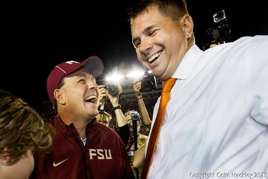 TALLAHASSEE, FL 11/2/13-FSU-MIAMI110213CH-Florida State Head Coach Jimbo Fisher, center, and son Trey, left greet University of Miami Heach Coach Al Golden prior to the game Saturday at Doak Campbell Stadium in Tallahassee. <br /> COLIN HACKLEY PHOTO