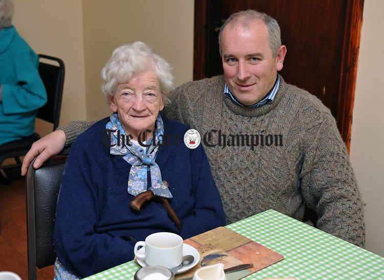 Safe and Sound again.... Mary O Donnell with her son Hugh in Rosemount Nursing home in Gort after being air lifted by Shannon Recue helicopter from their home at Beagh on Friday morning last, Gort. Photograph by John Kelly.