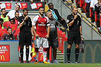 Arsenal's recent signing, Sead Kolasinac, who was named as a substitute gets ready to make an appearance during Arsenal vs Chelsea, FA Community Shield Football at Wembley Stadium on 6th August 2017
