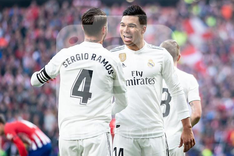 Sergio Ramos and Carlos Henrique Casemiro of Real Madrid celebrating a goal during La Liga match between Atletico de Madrid and Real Madrid at Wanda Metropolitano in Madrid Spain. February 09, 2018. (ALTERPHOTOS/Borja B.Hojas)