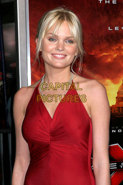 "SUNNY MABREY.The premiere of ""XXX: State of the Union"" held at the Mann Village Theatre, Westwood, California .April 25th, 2005.Photo Credit: Jacqui Wong/AdMedia.half length red dress halterneck gold necklace.www.capitalpictures.com.sales@capitalpictures.com.© Capital Pictures."