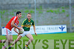 Danny Wrenn (Kerry) in action with John McLoughlin (Cork) in the Munster Junior Football Final at Austin Stack Park, Tralee on Wednesday