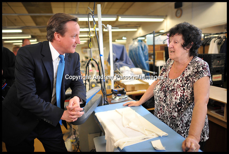The Prime Minister David Cameron Visits David Nieper factory in Derby, Monday April 16, 2012. Photo By Andrew Parsons/I-images