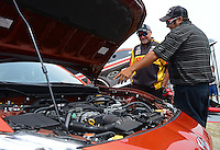 Jun. 29, 2012; Joliet, IL, USA: NHRA funny car driver Jeff Arend checks out the new Scion FR-S during qualifying for the Route 66 Nationals at Route 66 Raceway. Mandatory Credit: Mark J. Rebilas-