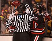 Wiley Sherman (Harvard - 25), Joe Ross, Nolan Stevens (NU - 21) - The Harvard University Crimson defeated the Northeastern University Huskies 4-3 in the opening game of the 2017 Beanpot on Monday, February 6, 2017, at TD Garden in Boston, Massachusetts.