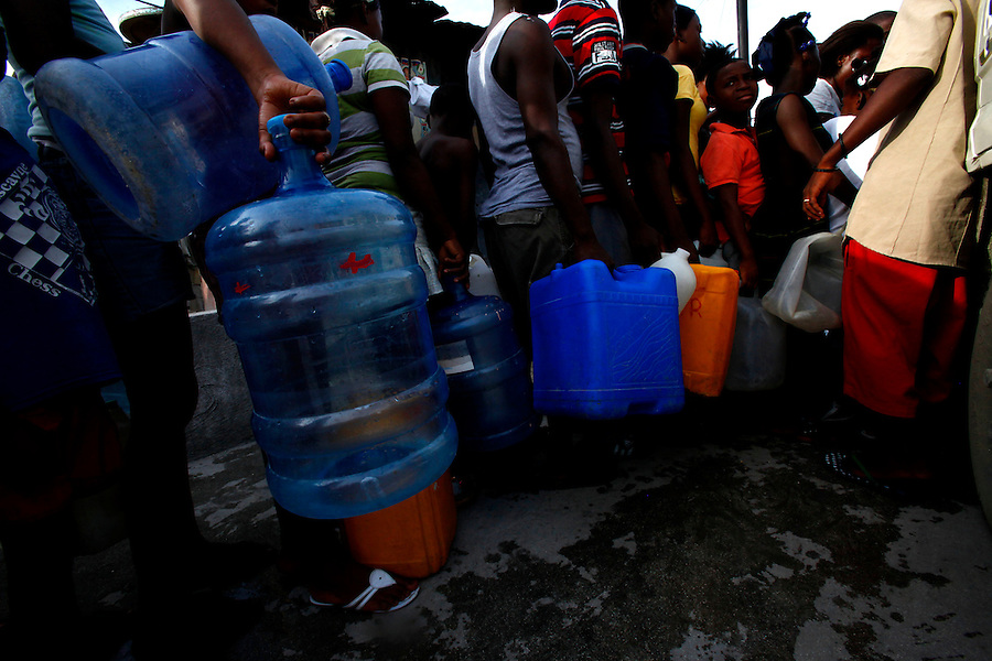 Nov 10, 2010 - Port-au-Prince, Haiti.Resident of one of the many tent cities in Port-au-Prince, Haiti line up for a free fresh water distributuion on Wednesday, November 10, 2010 as fears of a Cholera outbreak spread through the area just two days after cases of the infection were confirmed in the Haitian capital. Officials from the Pan American Health Organization warn that Haiti's cholera epidemic, spread primarily through consuming infected water and food, is likely to grow much larger in the wake of Hurricane Tomas.  (Credit Image: Brian Blanco/ZUMA Press)