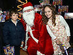 Clodagh and Eoin King pictured with santa at the Mell children's Christmas party. Photo:Colin Bell/pressphotos.ie