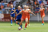 Houston, TX - Saturday May 27, 2017: Jess Fishlock and Camille Levin (22) of the Houston Dash battle for control of the ball during a regular season National Women's Soccer League (NWSL) match between the Houston Dash and the Seattle Reign FC at BBVA Compass Stadium.