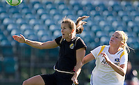 Brandi Chastain (left) goes up for the header against Katie Larkin (right). Los Angeles Sol defeated FC Gold Pride 2-0 at Buck Shaw Stadium in Santa Clara, California on May 24, 2009.